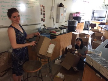 Jess Keating and Debbie Ohi breaking down boxes